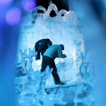 Sculptors work on sculptures based on characters from Disney movies at the Snow and Ice Sculpture Festival in Bruges